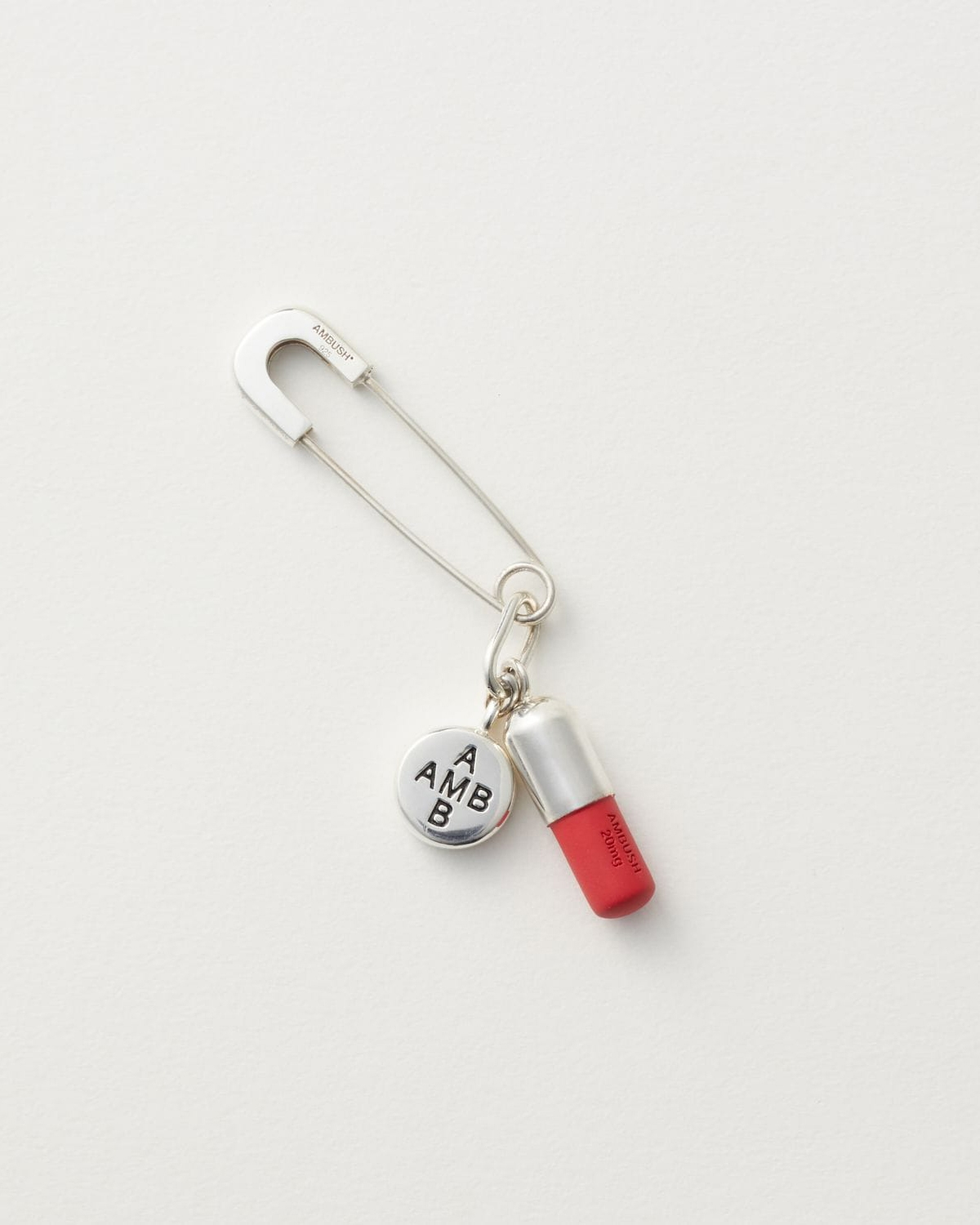 AMBUSH PILL CHARM EARRING